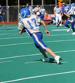 Youth Football Player Running With Ball