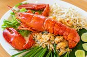 Lobster Pad thai, stir fried Thai rice noodle pasta with whole lobster and lobster meat. poster