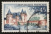FRANCE - CIRCA 1961: a stamp printed in France shows image of Sully-sur-Loire castle, the historic seat of the ducs de Sully. France, circa 1961