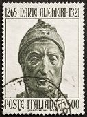 ITALY - CIRCA 1965: a stamp printed in Italy celebrates the seventh centenary of the birth of Dante Alighieri showing an image of  the famous italian poet. Italy, circa 1960