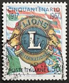 ITALY - CIRCA 1967: a stamp printed in Italy celebrates fiftieth anniversary of Lions Club Internati