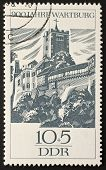 EAST GERMANY (DDR) - CIRCA 1966: a stamp printed in East Germany celebrates the ninth centenarian of