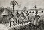 Old illustration of slaves in Unyamwezi region, Tanzania. Created by Bayard, published on Le Tour du