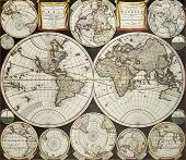 Old double emisphere map of the world surrounded by smallest emispheric projections. Created by Care