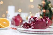 Christmas And New Years Eve Table With Fruit Pomegranate.fruit Pomegranate In A Winter Composition poster