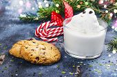 Melting Snowman Cocktail With Ice Cream And Chocolate Chips Cookies On Festive Christmas Background poster
