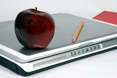 Laptop, Red Apple, Pencil And Book