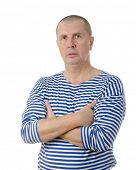 Portrait of a confident seaman standing with folded hand isolated on white background
