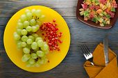 Grapes, Pomegranate Isolated On White Background. Grapes, Pomegranate On A Plate poster