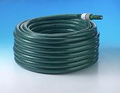 Close-up of green conventional hose pipe