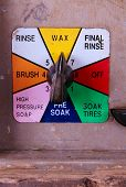 picture of car wash  - A self service car wash knob selector and coin dispenser - JPG