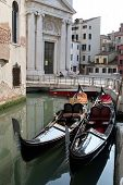 Two gondolas in a small chanel (Venice, Italy)