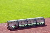 stock photo of dynamo  - Coach bench near the field - JPG