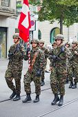 ZURICH - AUGUST 1: Infantery division of Swiss army marching in the Swiss National Day parade on Aug