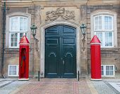 Gate to the Amalienborg castle in Copenhagen, Denmark