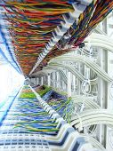picture of computer technology  - a shot of network cables and servers in a technology data center - JPG