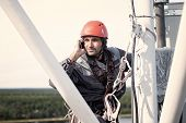Tower Technician Talking On A Cell Phone On A Telecommunications Tower. The Concept Of Checking Cell poster