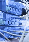 switch with network cables and servers in a technology data center