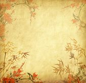 image of orientation  - bamboo and plum blossom on old antique paper texture - JPG