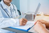 Healthcare Medical Concept. Woman Doctor Writing Prescription Clipboard With Record Information Pape poster