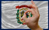 Ok Gesture In Front Of West Virginia Us State Flag