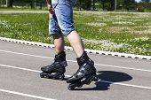 Man on roller skates in stadium in summer