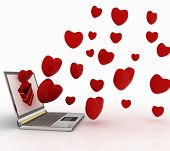 hearts take off from the screen of laptop