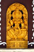 stock photo of lakshmi  - Indian  Wooden statue of Hindu goddess  Lakshmi - JPG