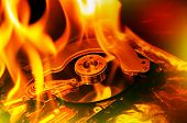 foto of combustion  - Close up image of computer hard disk on fire burning in flasmes - JPG