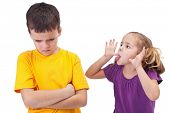 Mocking and teasing among children - girl taunting upset boy, isolated
