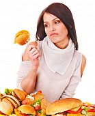 Woman holding hamburger. Isolated.