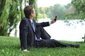 Businessman Having A Break In The Park