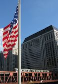 CTA TRAIN AND AMERICAN FLAG IN CHICAGO, ILLINOIS