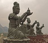 Statues In Front Of Buddha In Hong Kong