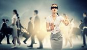 picture of struggle  - Image of businesswoman in blindfold walking among group of people - JPG