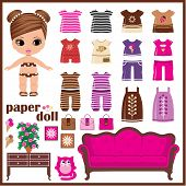 stock photo of baby doll  - A set of clothes for dolls out of paper - JPG