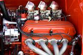 foto of carburetor  - Details of 4 cylinder petrol engine painted red  - JPG