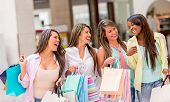 Group of shopping women having fun and smiling