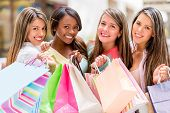 Happy group of shopping women wish bags and smiling