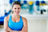 Fit woman at the gym looking very happy