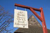 Sign Advertizing Shields Tavern In Colonial Williamsburg, Virginia, Against A Bright Blue Sky