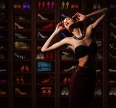 Sensual Woman in Wardrobe with Plenty of Footwear