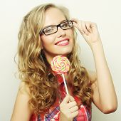 Nice blond  girl with  lolipop