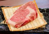 foto of shabu  - Close up Freshness Marbled on Japanese Kobe Matsusaka Beef for BBQ On The Plate in Restaurant King of Beef - JPG