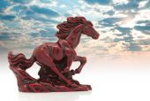 Old-fashioned Figurine Red Horse On Sky