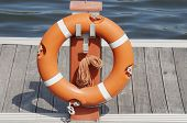 forefront of a orange lifeguard in a port