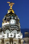 view of the famous Metropolis Building, located at the intersection of  Gran Via and Alcala, Madrid, Spain