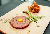 Beef tartare with french fries and avocado, close-up