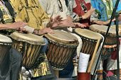pic of congas  - jembe player in group wich percussion  instrument - JPG