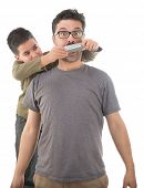 Cute boy tapes his father's mouth with duct tape isolated on white background